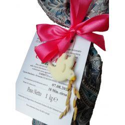 Dettaglio della colomba in amido di mais presente sui sacchetti decorati a tema Pasqua.